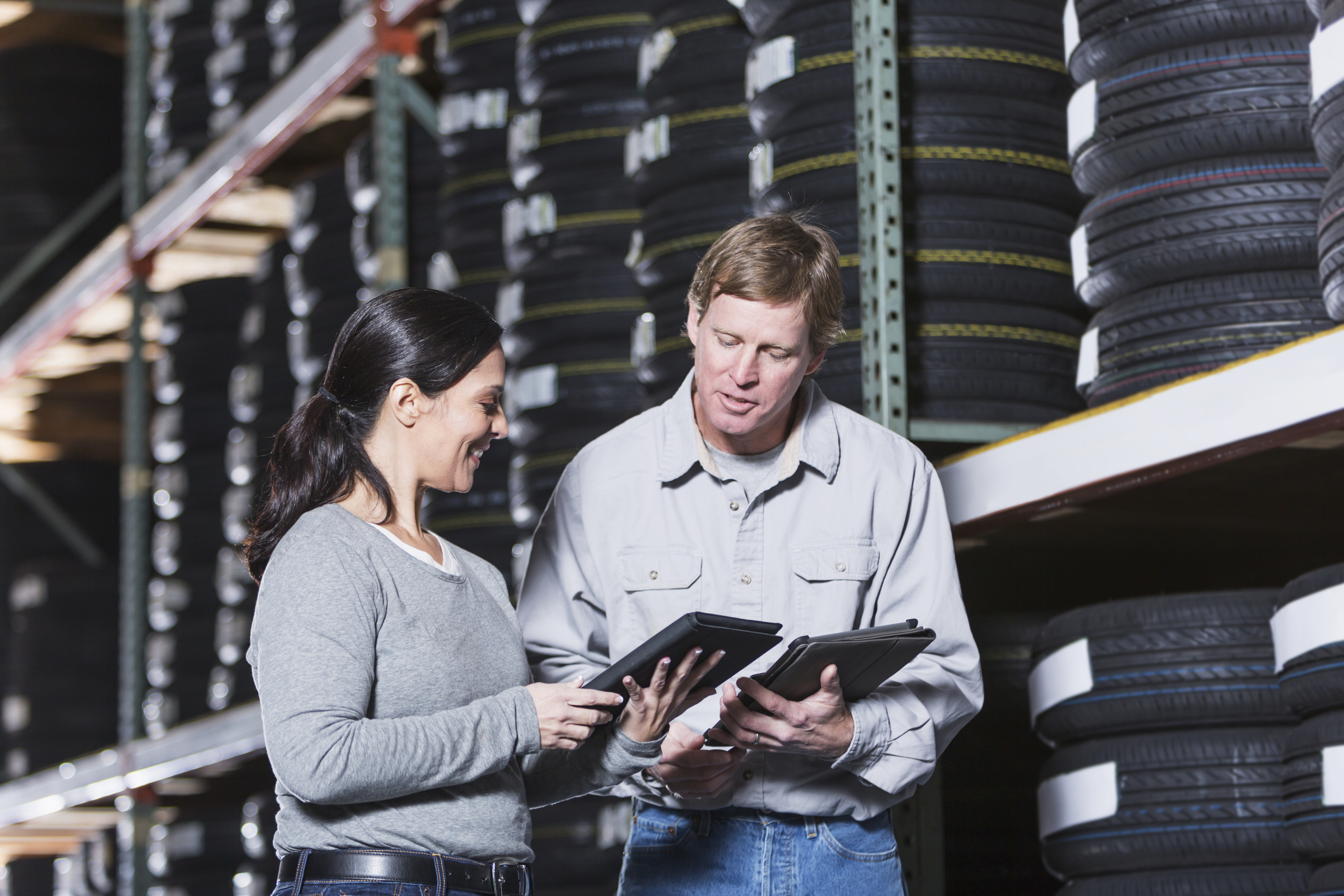 Workers in warehouse with tires counterpoint retail pos