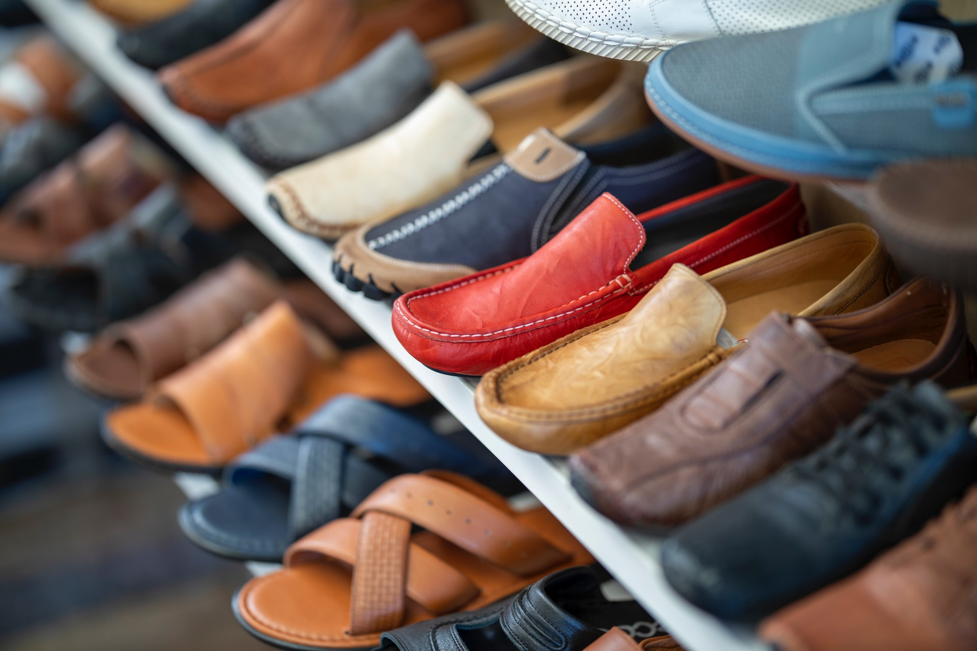 assorted colors shoes sitting on rack in counterpoint retail footwear store