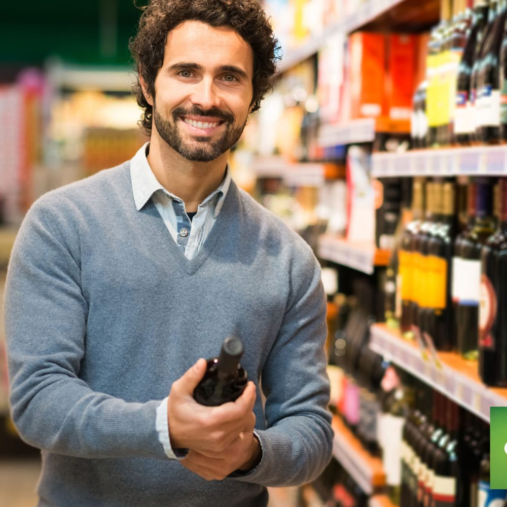 man holding wine bottle near store shelf using counterpoint commerce
