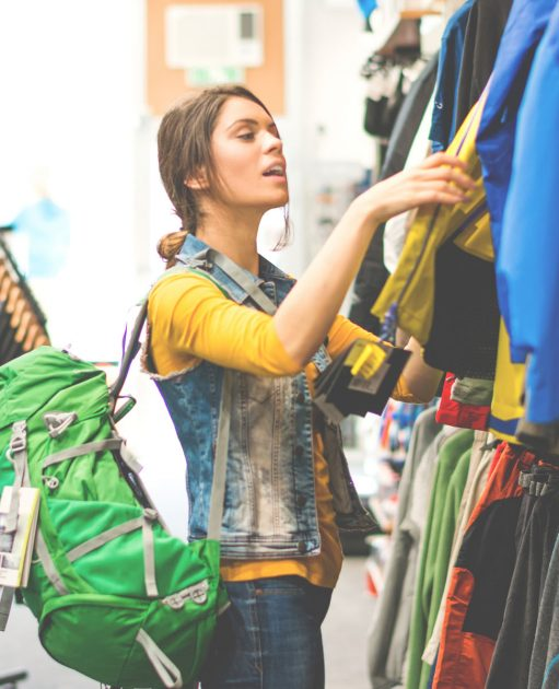 Counterpoint Sporting Goods Customer Woman Holding Clothing Goods