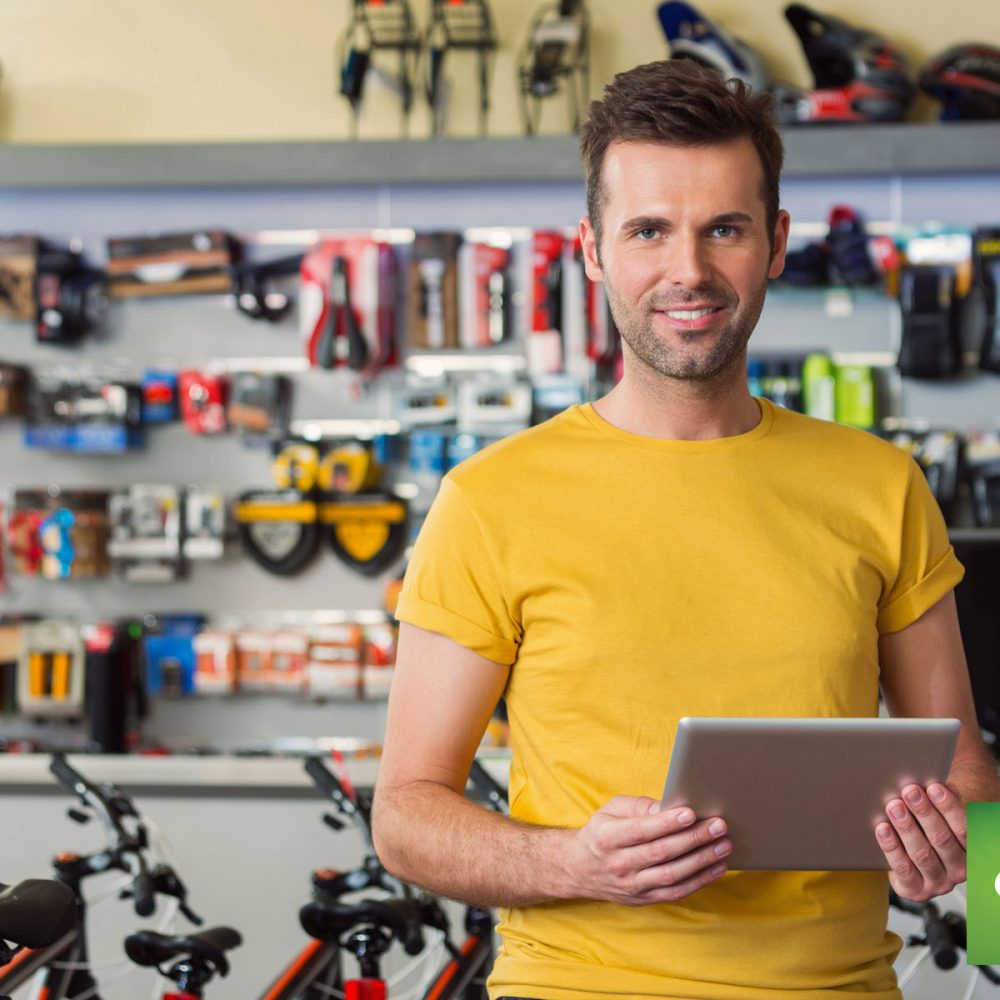 Counterpoint Sporting Goods holding iPad Counterpoint Retail SQL Magento 2