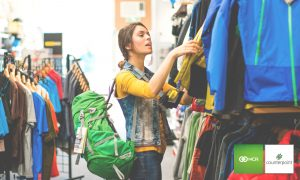 cp retail sporting goods store woman in front of goods shopping
