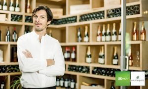 Cp Retail Wine and Liquor Man in Front of Wine Bottles