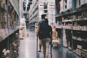 cp retail point of sale customer walking through hardware store aisle